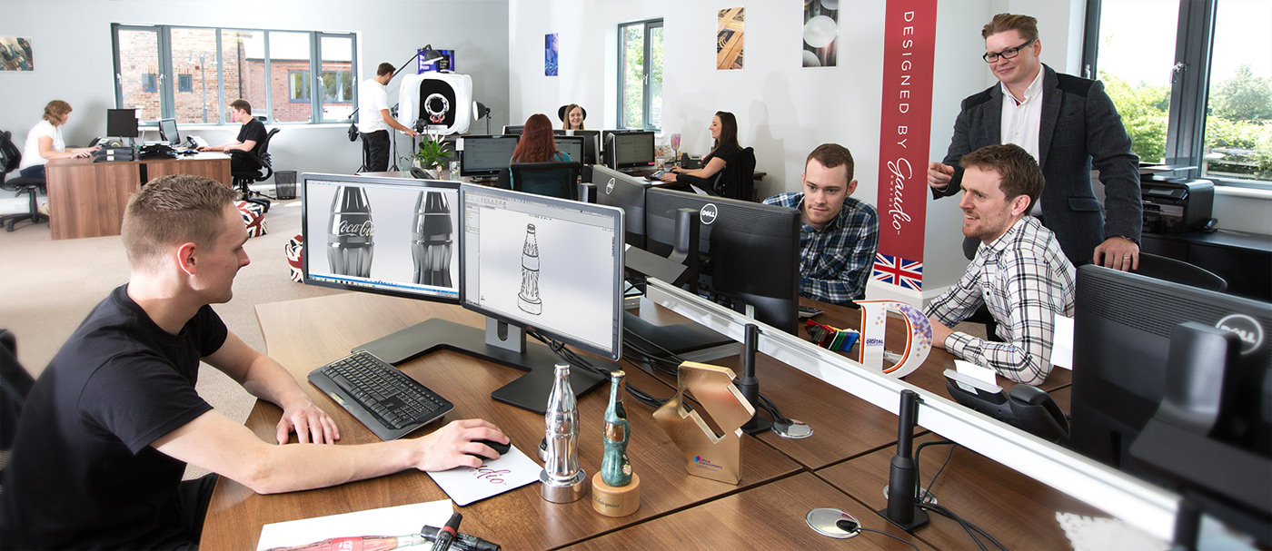 The gaudio team working on bespoke awards in the office