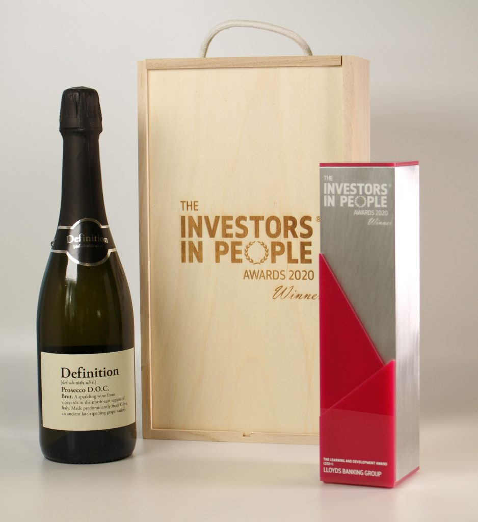 Image of aluminium investors in people award, alongside an engraved wooden gift box and a bottle of wine