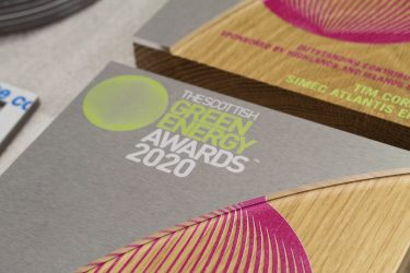 Close up photo of the Scottish Green Energy Awards logo printed onto brushed aluminium