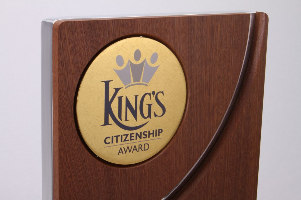 photo of the kings school logo printed onto gold aluminium in the top left corner of the custom citizenship award
