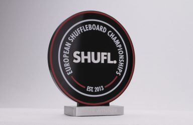 Custom award with a black top and aluminium base for the european shuffleboard awards
