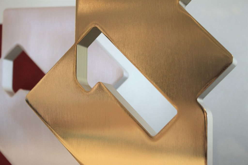 Profiled metal chartd award with a smooth gold finish