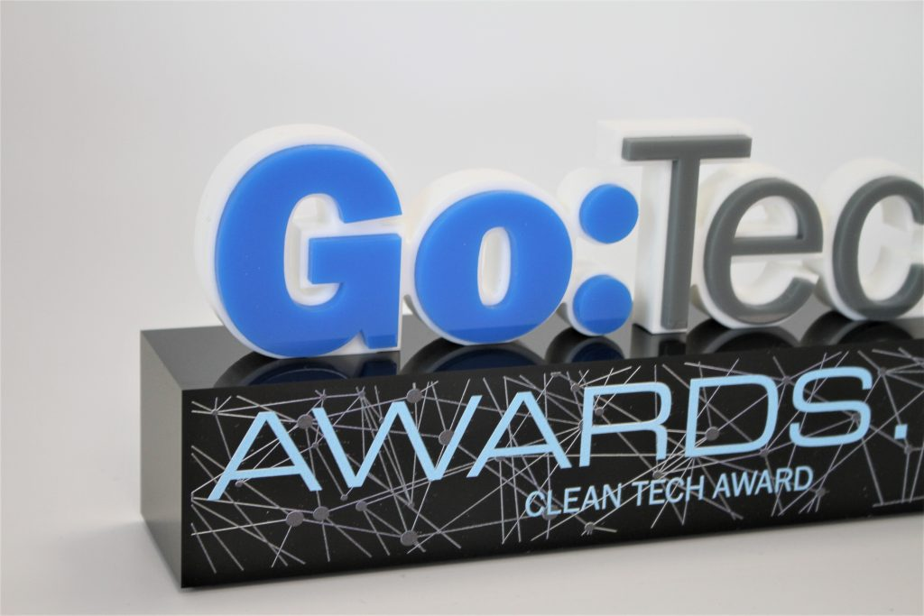 The blue and white top of the GoTech award on a black base
